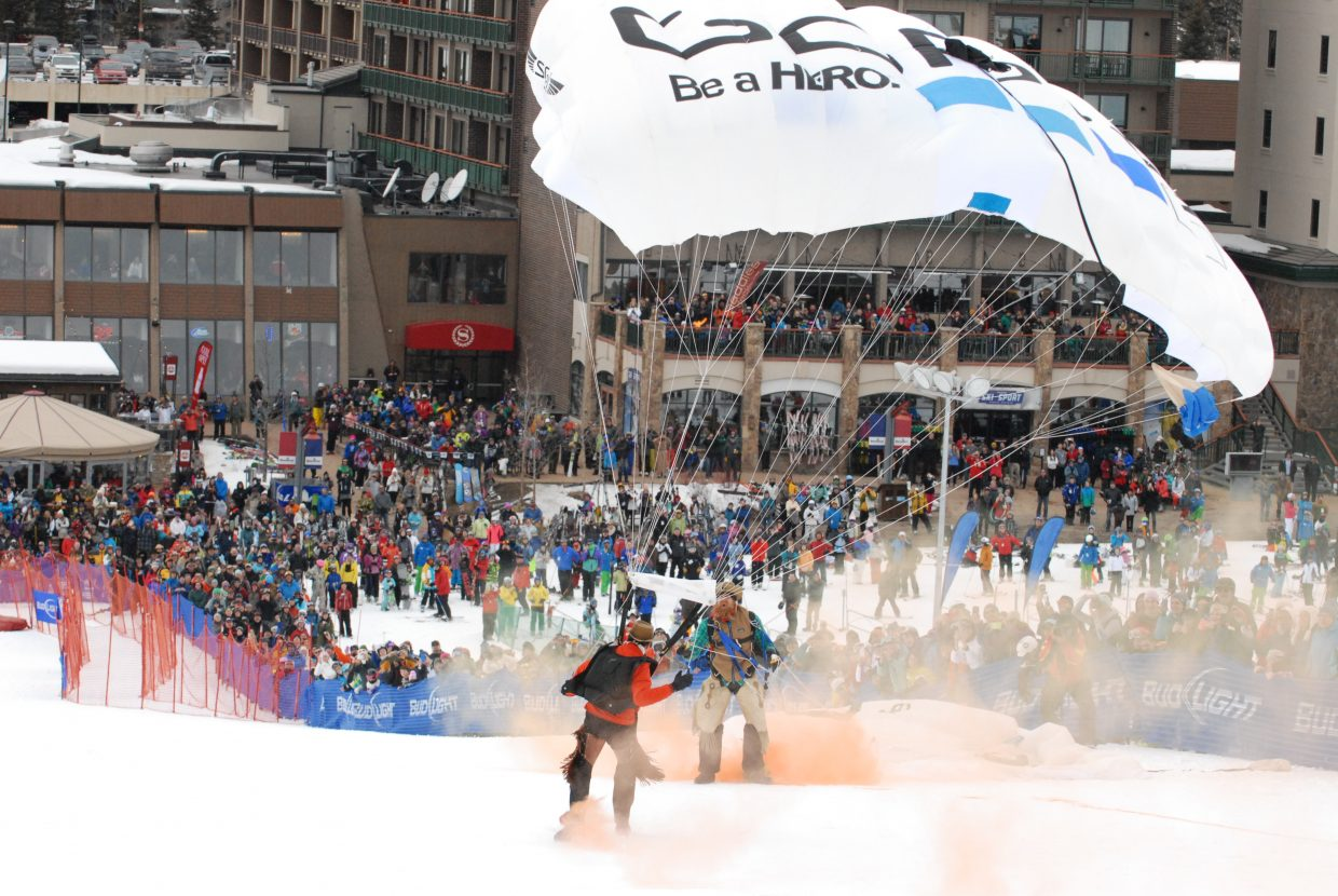 The GoPro Bomb Squad thrilled the crowd that assembled in Gondola Square to watch the Steamboat Ski Area's 41st annual Bud Light Cowboy Downhill. Three jumpers parachuted out of a helicopter between the slalom and stampede races.
