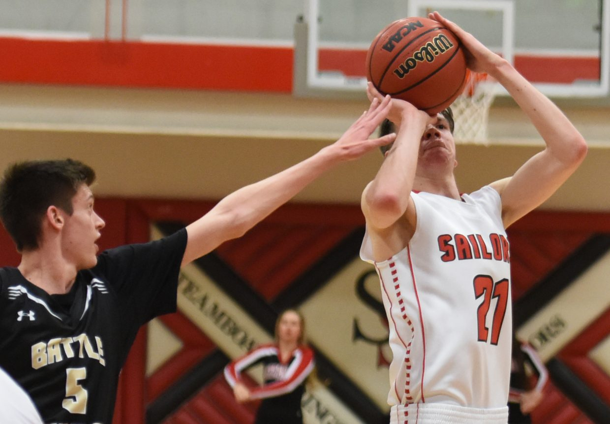 Steamboat's John Zalesky tries to get a shot off with a hand in his face Tuesday against Battle Mountain.