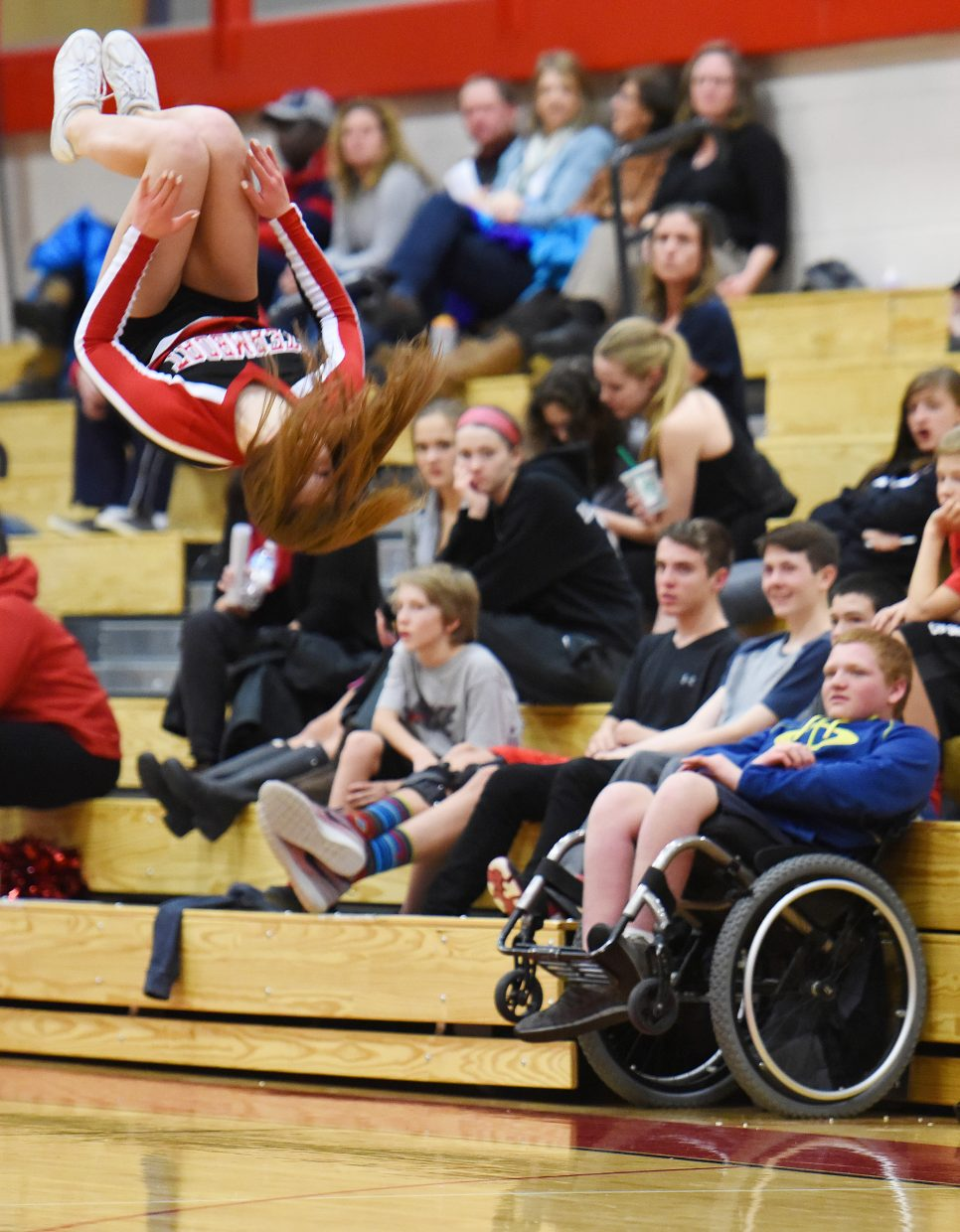 Steamboat sophomore cheerleader Taylor Rogers flips above the crowd Tuesday during the Steamboat Springs boys basketball game.