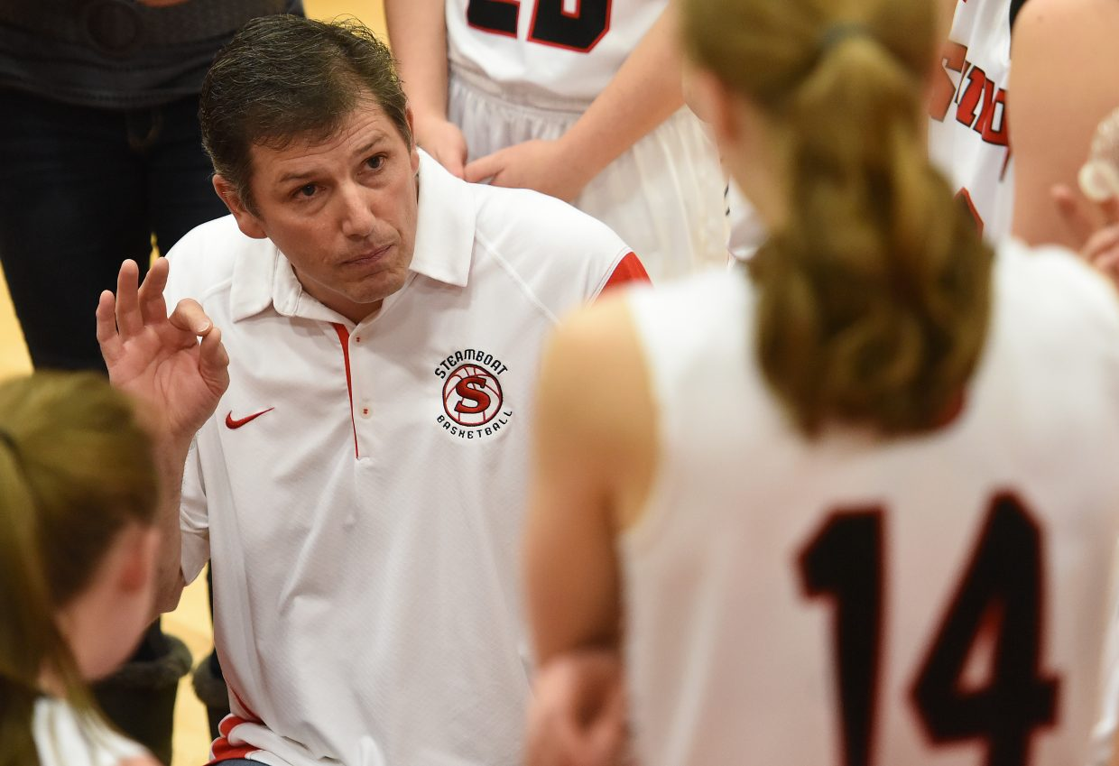 Steamboat coach Mack Spitellie gives his team directions during halftime of Tuesday's game against Battle Mountain. Spitellie missed four games because of an illness to start the month, but helped guide his team to a win Tuesday.