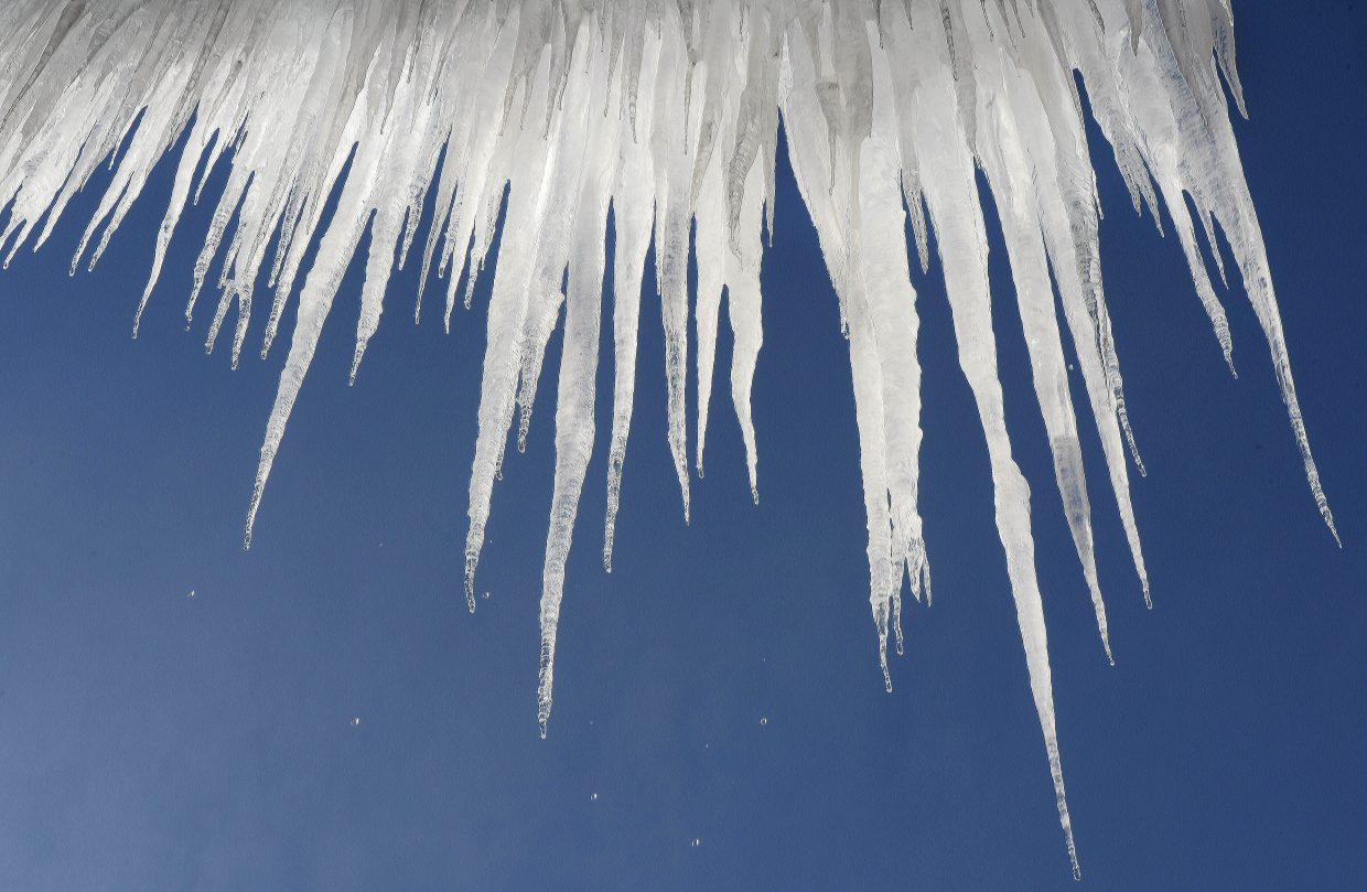Water drips from icicles hanging from a roof in Steamboat Springs. Blue skies and warmer temperatures returned to the valley Tuesday afternoon, prompting January thaw.