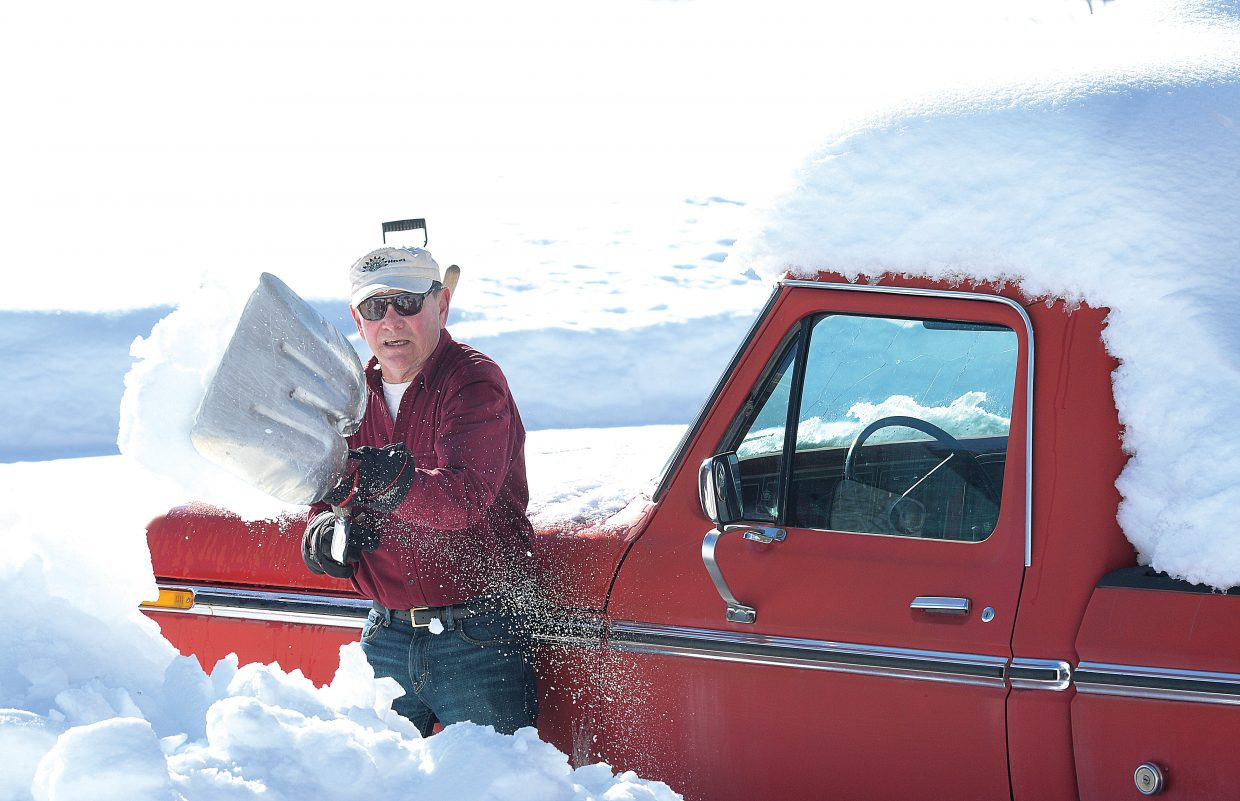 North Routt resident Harry Delashmutt digs his truck out of a snowbank Thursday afternoon. Delashmutt would normally let the old truck sit in the snow until spring, but he needed the truck, which is slightly bigger than his new one, to get his snowblower to the shop for some much needed repairs.