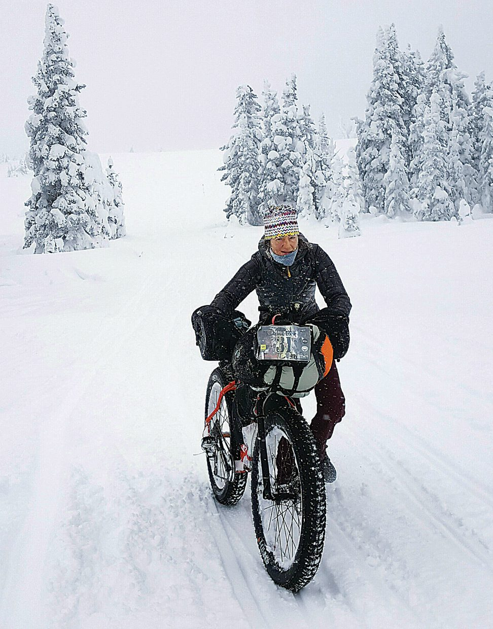 Kellie Neson pushes her bike along the trail during the Jay P's Backyard Fat Pursuit during the weekend. Nelson competed in the 200-kilometer race, while fellow local rider Graham Muir competed in the 200-mile race. The two joined forces halfway through, but conditions kept them from completing the ride.