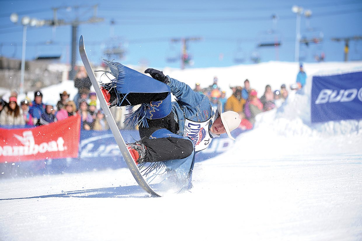 Jake Watson, a saddle bronco rider from British Columbia, cartwheels down the slopes of the Steamboat Ski Area during the 40th annual Cowboy Downhill at the base of Steamboat Ski Area. Top cowboys at this year's event included Jed Moore, who won the dual slalom, and Yvan Jayne, who finished first in the stampede.
