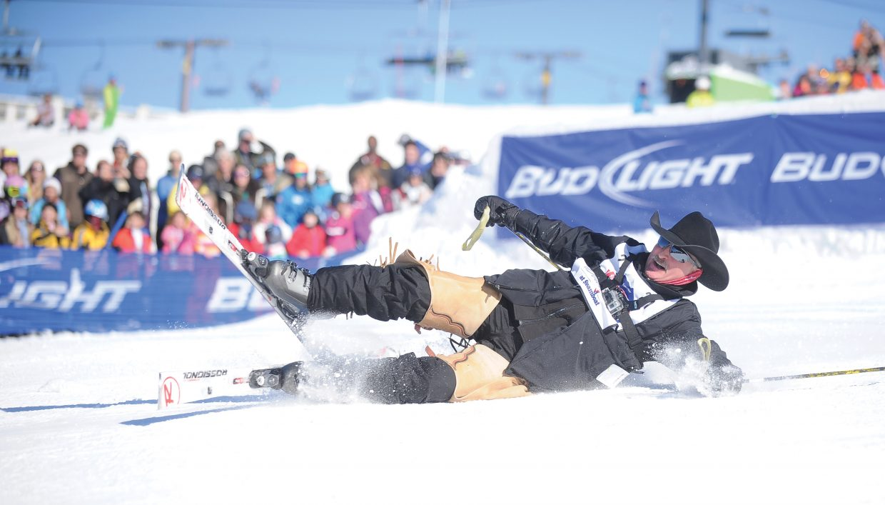 Clint Corey, of Texas, takes a hard fall after landing off the jump in the middle of the 40th annual Cowboy Downhill at the base of Steamboat Ski Area Monday afternoon.