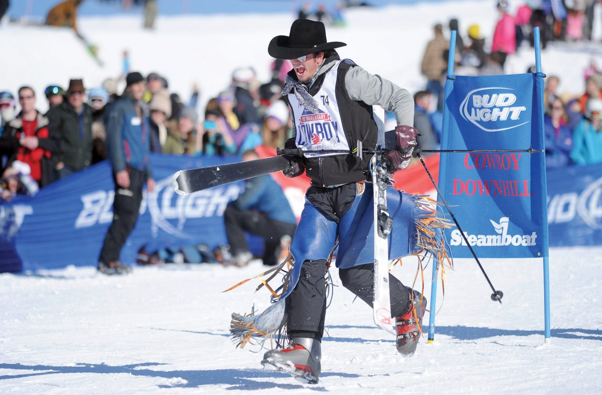 Michigan cowboy Nic Lica sprints toward the finish line after crashing in the 40th annual Bud Light Cowboy Downhill Monday afternoon at the base of Steamboat Ski Area.