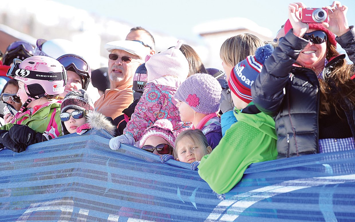 Fans lined up early to get the best spot to watch the 40th annual Cowboy Downhill at the base of Steamboat Ski Area Monday afternoon.