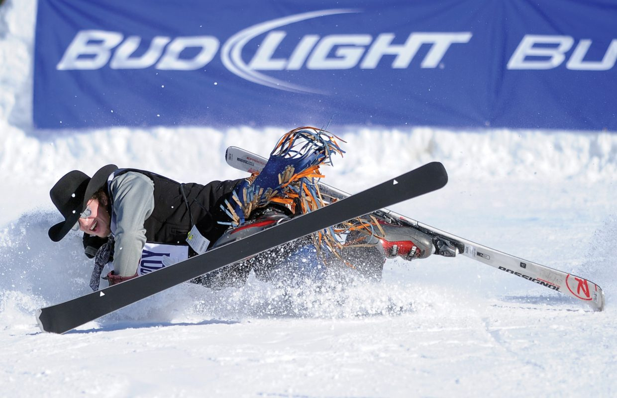 Nic Lica, of Michigan, crashes shortly after landing off the jump in the 40th annual Bud Light Cowboy Downhill Monday afternoon at the base of Steamboat Ski Area.