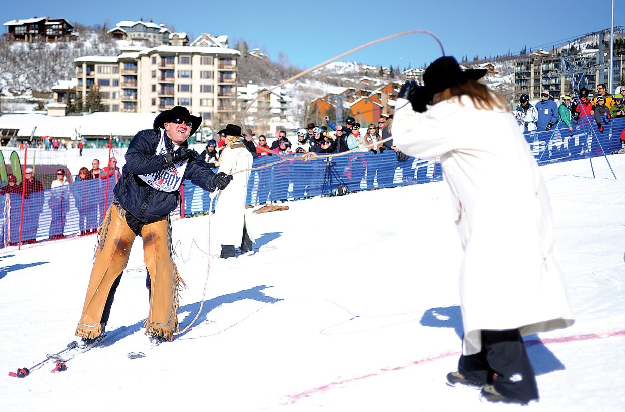 Colorado's Wyatt Johnson ropes a Steamboat Ski Area employee as part of the 40th annual Bud Light Cowboy Downhill Monday at the base of Steamboat Ski Area.