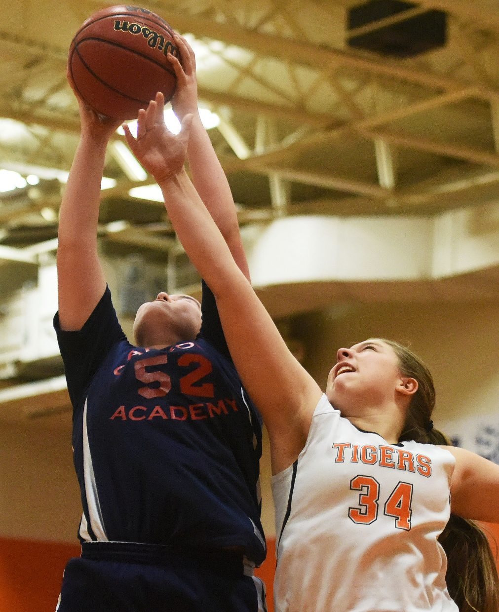 Hayden's Hailee Smith reaches for a rebound Friday.