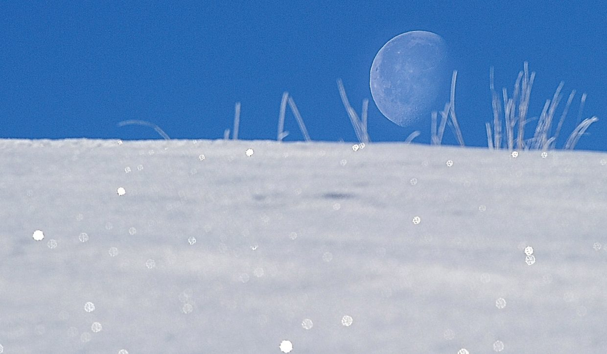 The moon was clearly visible Tuesday morning against a bright blue mountain sky in Steamboat Springs.