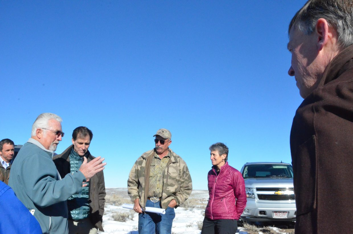 Gov. John Hickenlooper, right, joins U.S. Interior Secretary Sally Jewell on a tour of Bord Gulch Ranch in Moffat County. The ranch is owned by Ray Owens, who highlighted efforts he's made to help sage grouse, mule deer and elk populations thrive in Northwest Colorado. Moffat County Commissioner Tom Mathers, left, talks about sage grouse in the region.