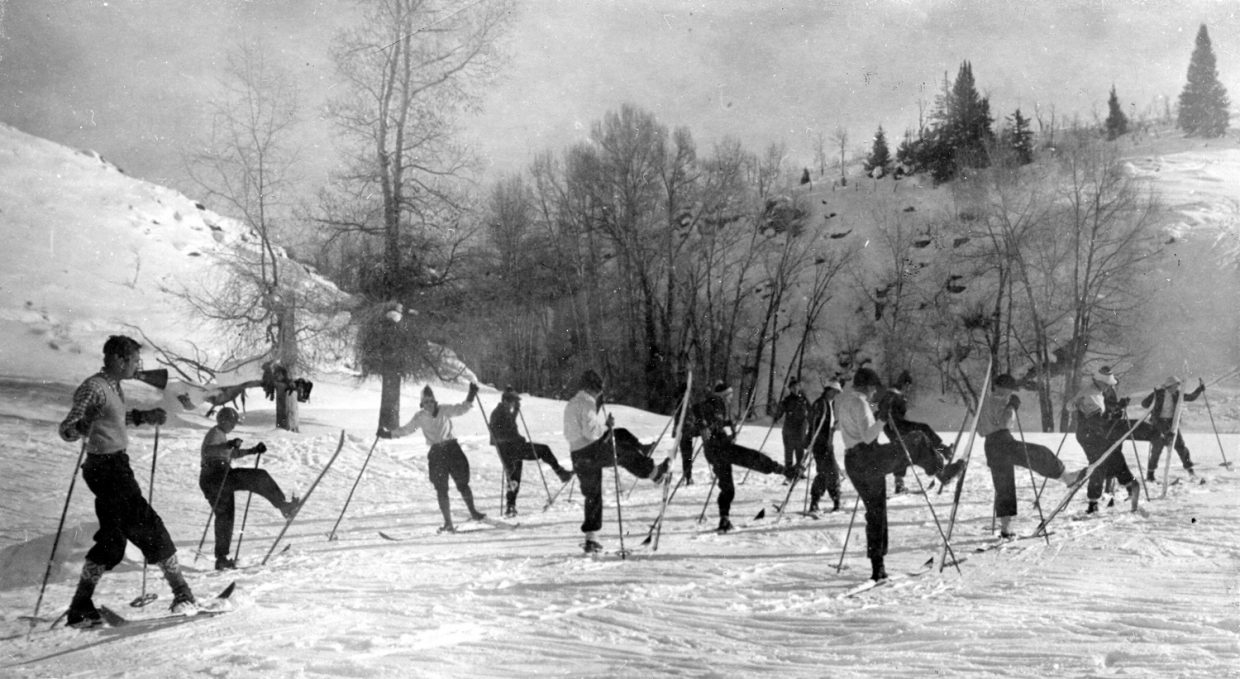 Members of the Ladies Recreation Club in Steamboat Springs practice their kick turns under the supervision of an instructor.