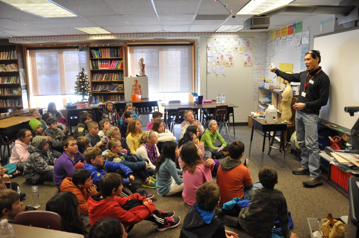 Tim Lim leads a discussion about weather balloons Wednesday morning at Strawberry Park Elementary School.