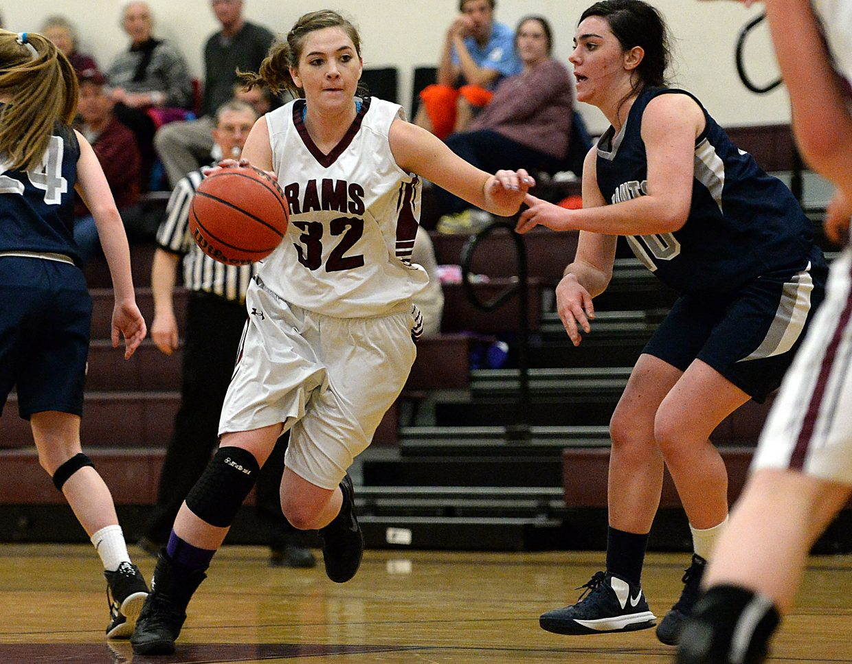 Jacey Schlegel drives through the defense Wednesday against Vail Christian. She scored 24 to help the Rams to a big win.