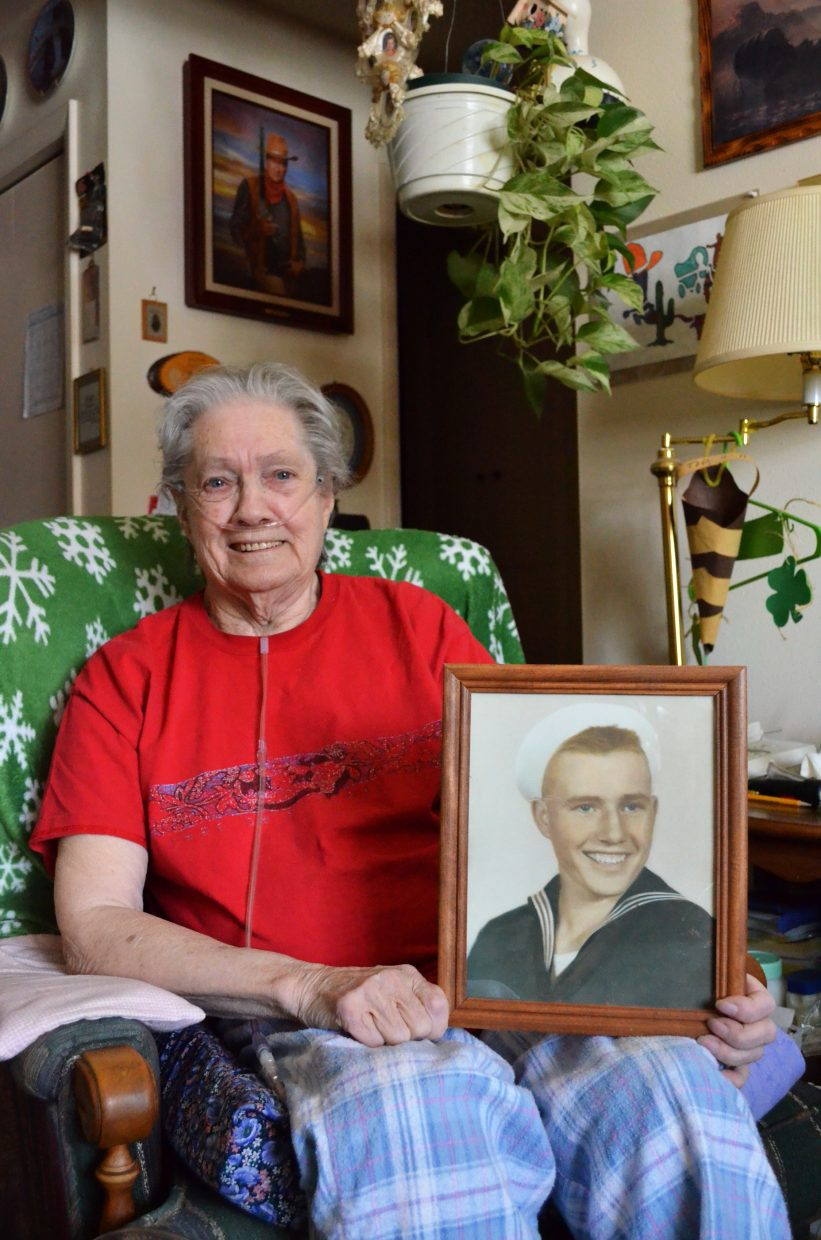 Former Oak Creek Mayor Vi Shaffer holds a photograph of her late brother Navy Fireman 2nd Class Philip Jess Vawter, who died at the age of 17 in November 1943 when the aircraft carrier he was serving on was struck by a torpedo fired from a Japanese submarine. Shaffer's family was notified that Jess Vawter would be awarded a Purple Heart, but she never saw it and her relatives had never talked about its existence. Early this winter, after years of trying, she received a duplicate Purple Heart and several other medals honoring the brother she lost when she was just 8 years old.