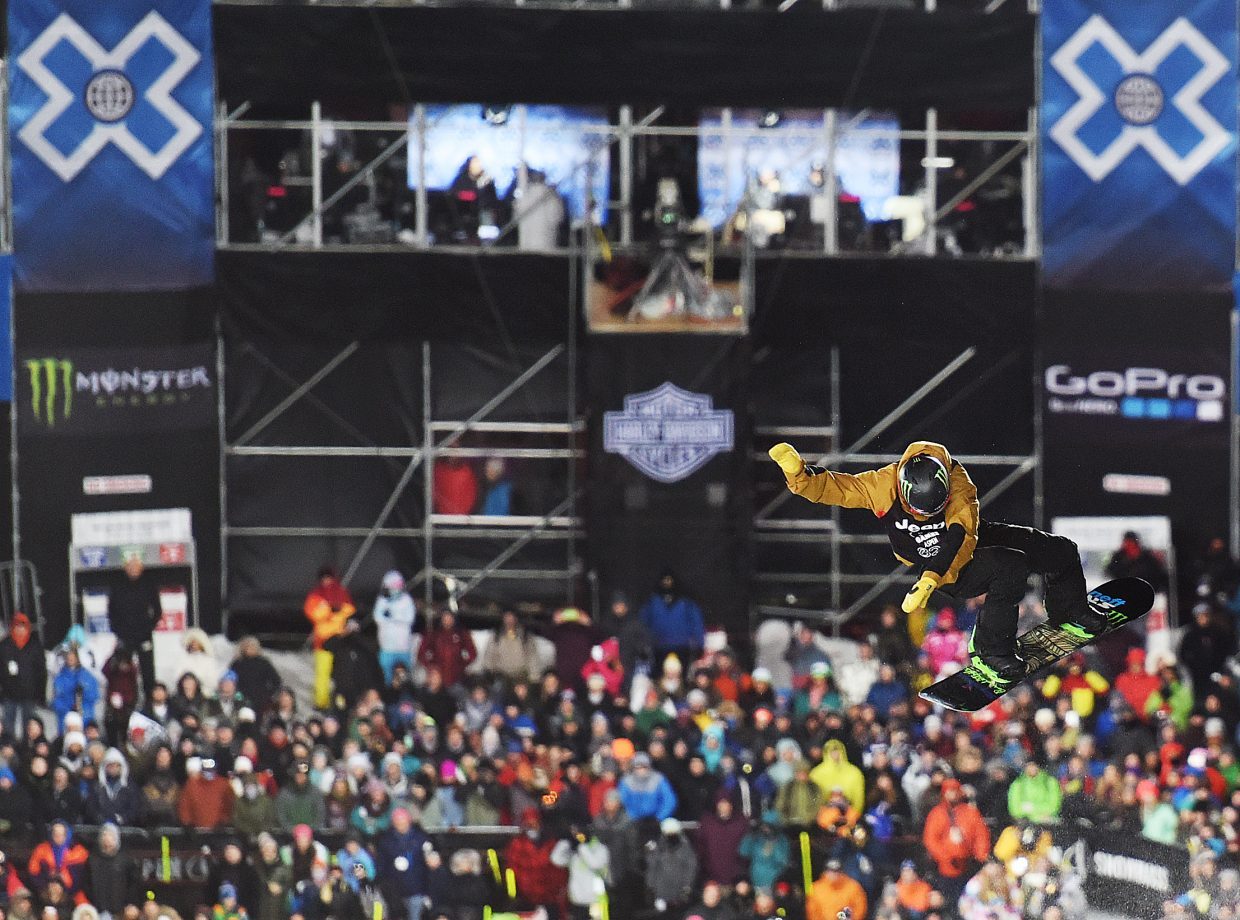 Taylor Gold spins above the crowd at X Games on Thursday night. The Steamboat Springs snowboarder couldn't advance out of the event's qualification round.