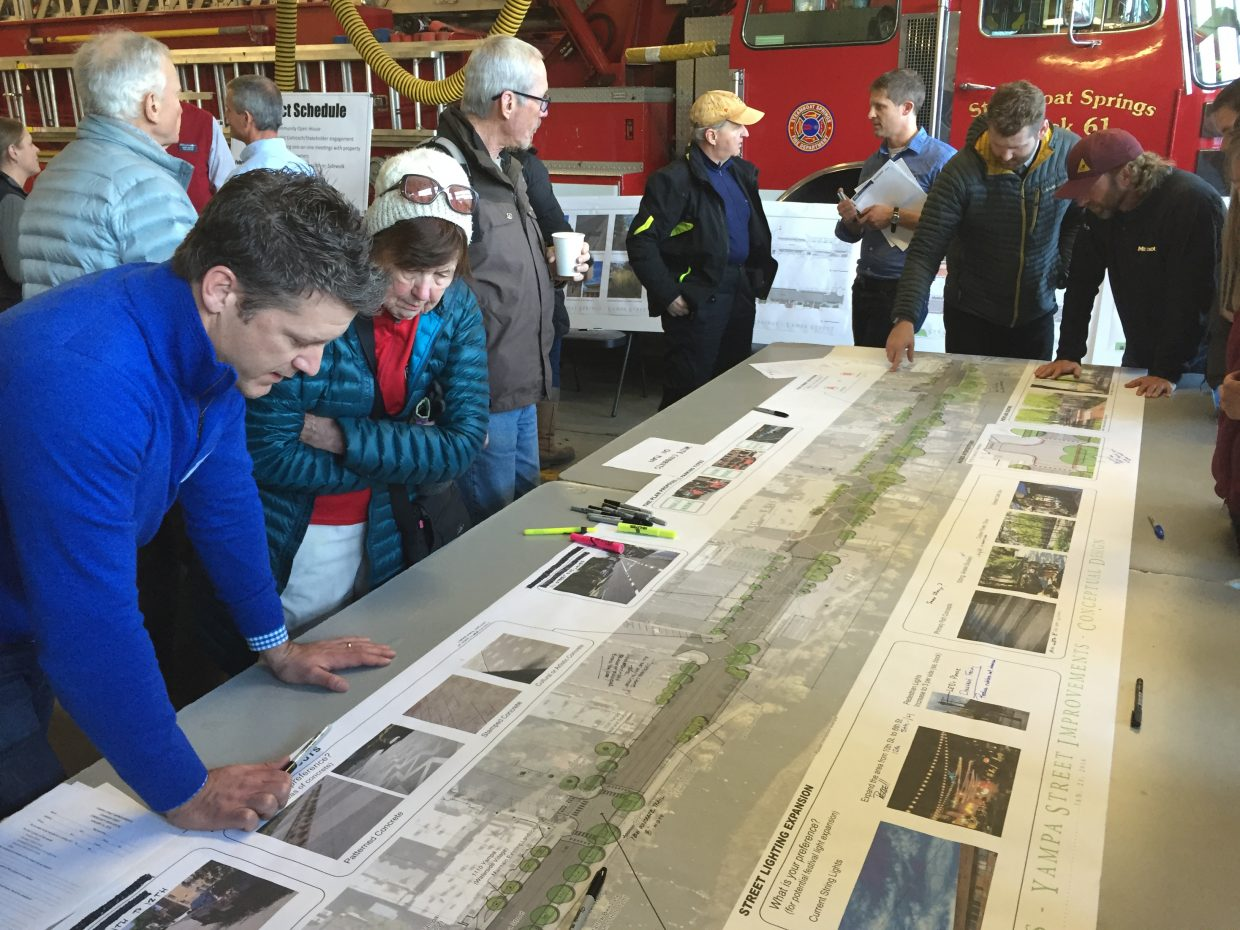 Community members look at the proposed layout of Yampa Street improvements during an open house at the downtown fire station.
