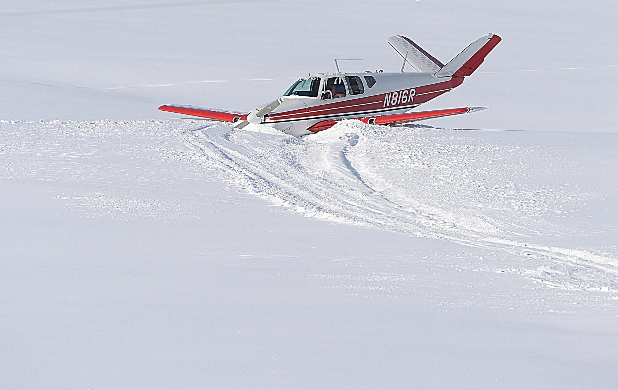 A Beech K-35 Bonanza aircraft sits in a field just north of the Steamboat Springs Airport Friday afternoon. The pilot walked away from the plane after t came down into the field.