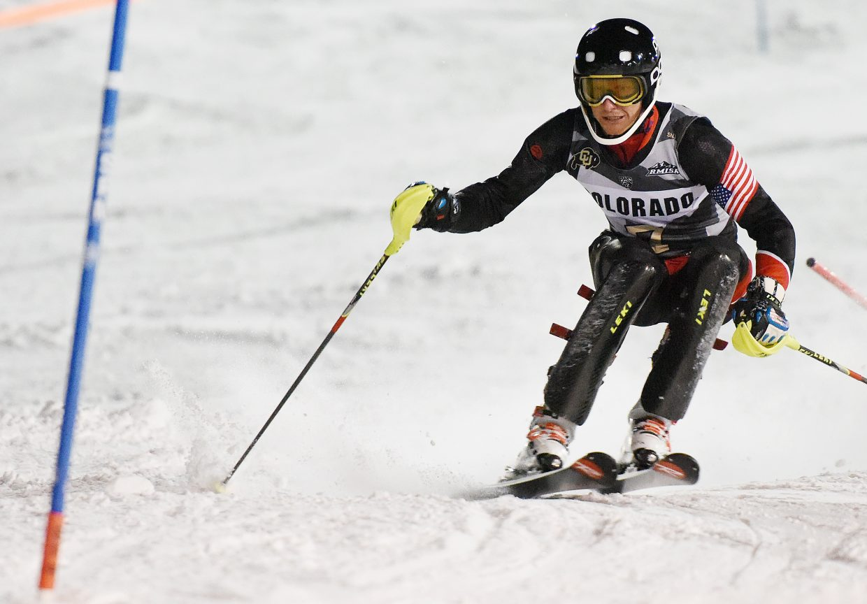 Seppi Stiegler cuts through a slalom course on Howelsen Hill in Steamboat Springs on Friday. Stiegler went on to win the men's race.