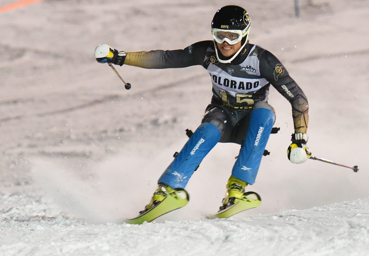University of Colorado skier Henrik Gunnarsson pops into the air while trying to make a turn Friday during a slalom race at Howelsen Hill. Gunnarsson went on to finish second overall and first among NCAA skiers in the race.