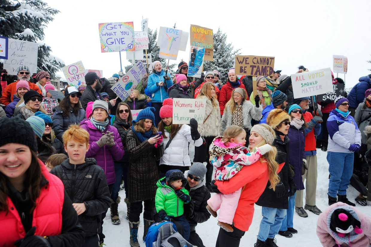 Women's March on Steamboat Springs participants hold signs during a rally Jan. 21, 2017, at the Routt County Courthouse. Another Women's March is planned for Sunday in Steamboat.