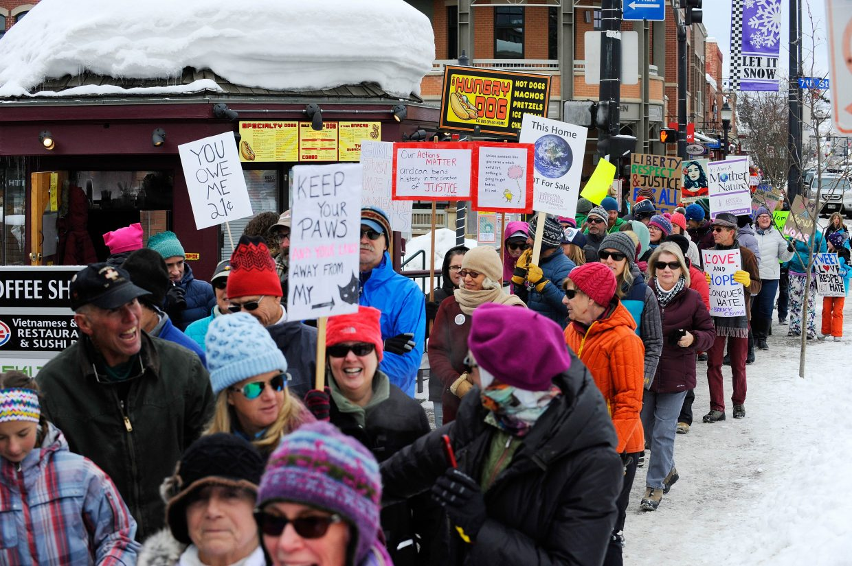 People walk down Lincoln Avenue during Saturday's Women's March on Steamboat Springs.