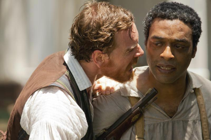 "Solomon Northup (Chiwetel Ejiofor) is threatened by slave owner Edwin Epps (Michael Fassbender) in ""12 Years a Slave."" The movie is a true story about a free black man in the 1840s who is forced into slavery for more than a decade. It also is film critic Andy Bockelman's selection as the best film of 2013."