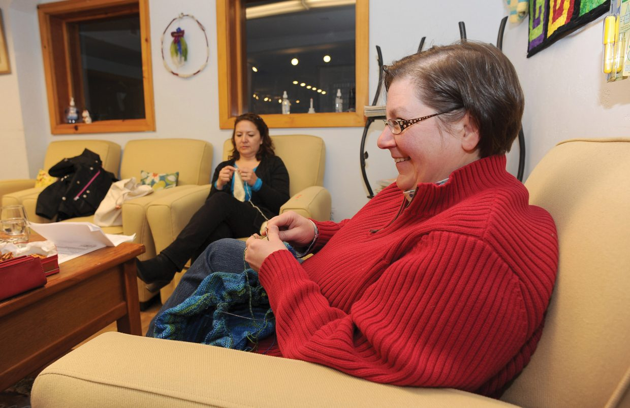 Instructor Lori Bourgeois works with student June Silva at Sew Steamboat's learn to knit class.