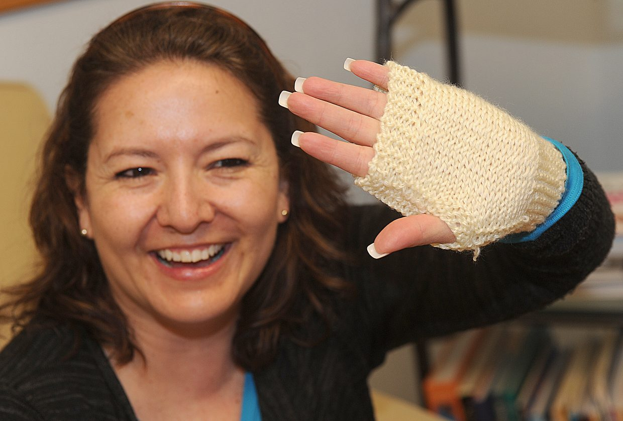 Knitting student June Silva shows off the mitt she created in a class offered at Sew Steamboat.