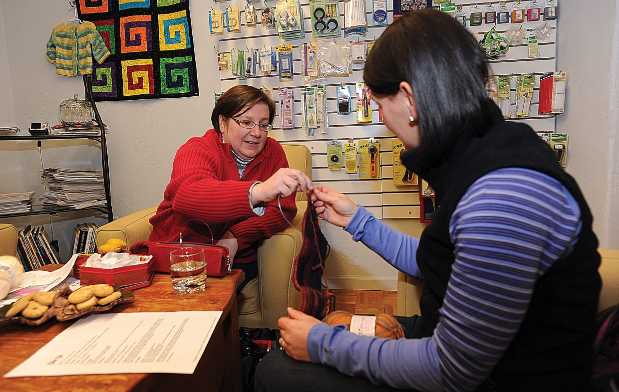 Instructor Lori Bourgeois works with student Jennifer Grosjean at Sew Steamboat's learn to knit class.