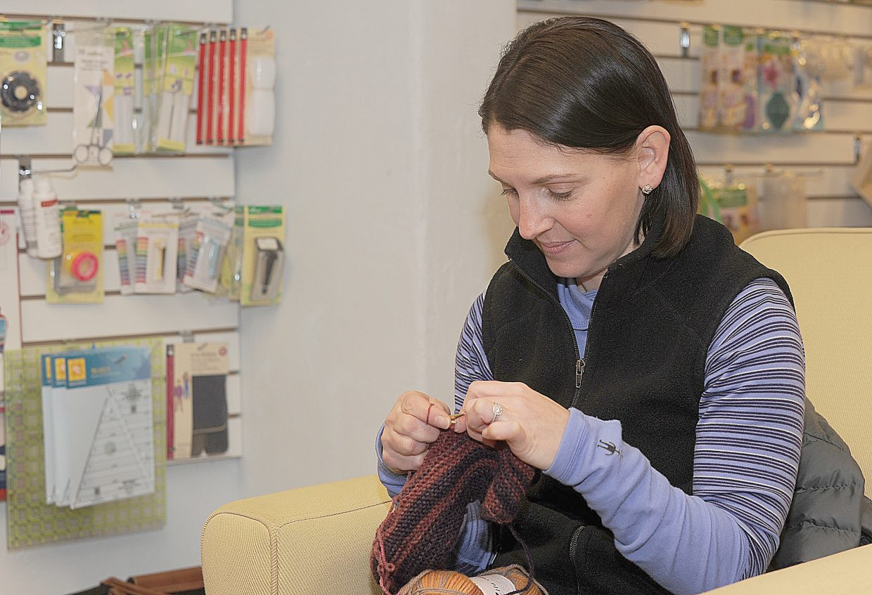 Knitting student Jennifer Grosjean works on a project in a class offered at Sew Steamboat.