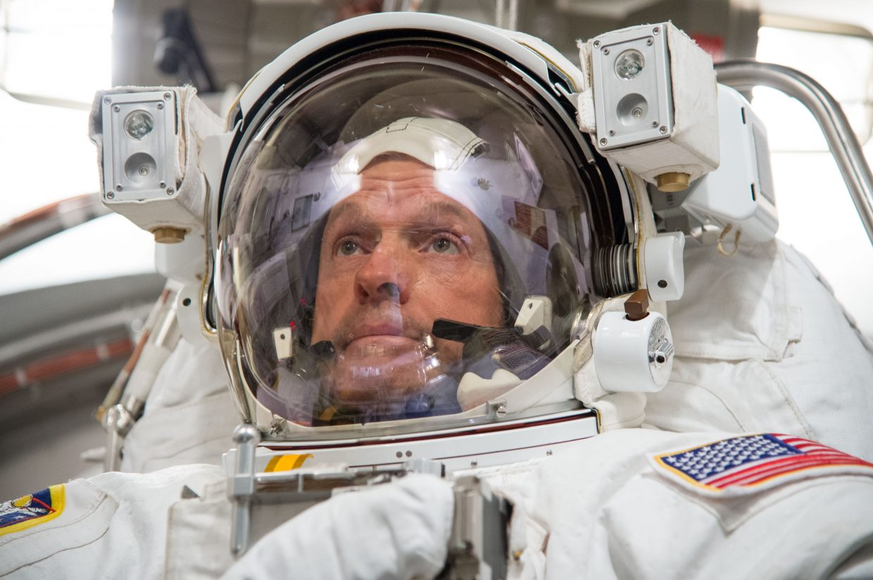 NASA astronaut Steve Swanson participates in an Extravehicular Mobility Unit spacesuit fit check in the Space Station Airlock Test Article of the Crew Systems Laboratory at NASA's Johnson Space Center.