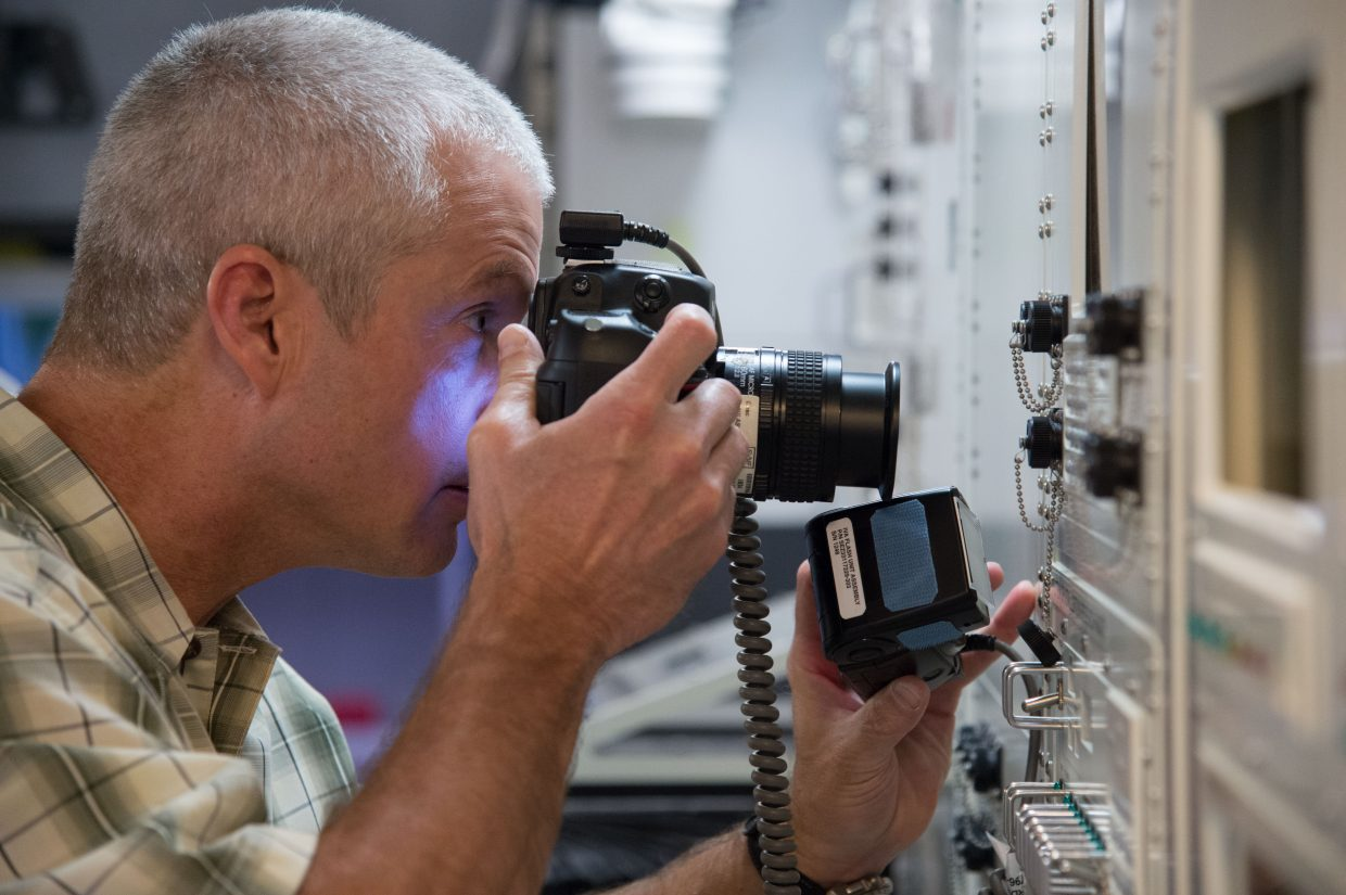 NASA astronaut Steve Swanson participates in a photography training session in an International Space Station mock-up trainer in the Space Vehicle Mock-up Facility at NASA's Johnson Space Center.