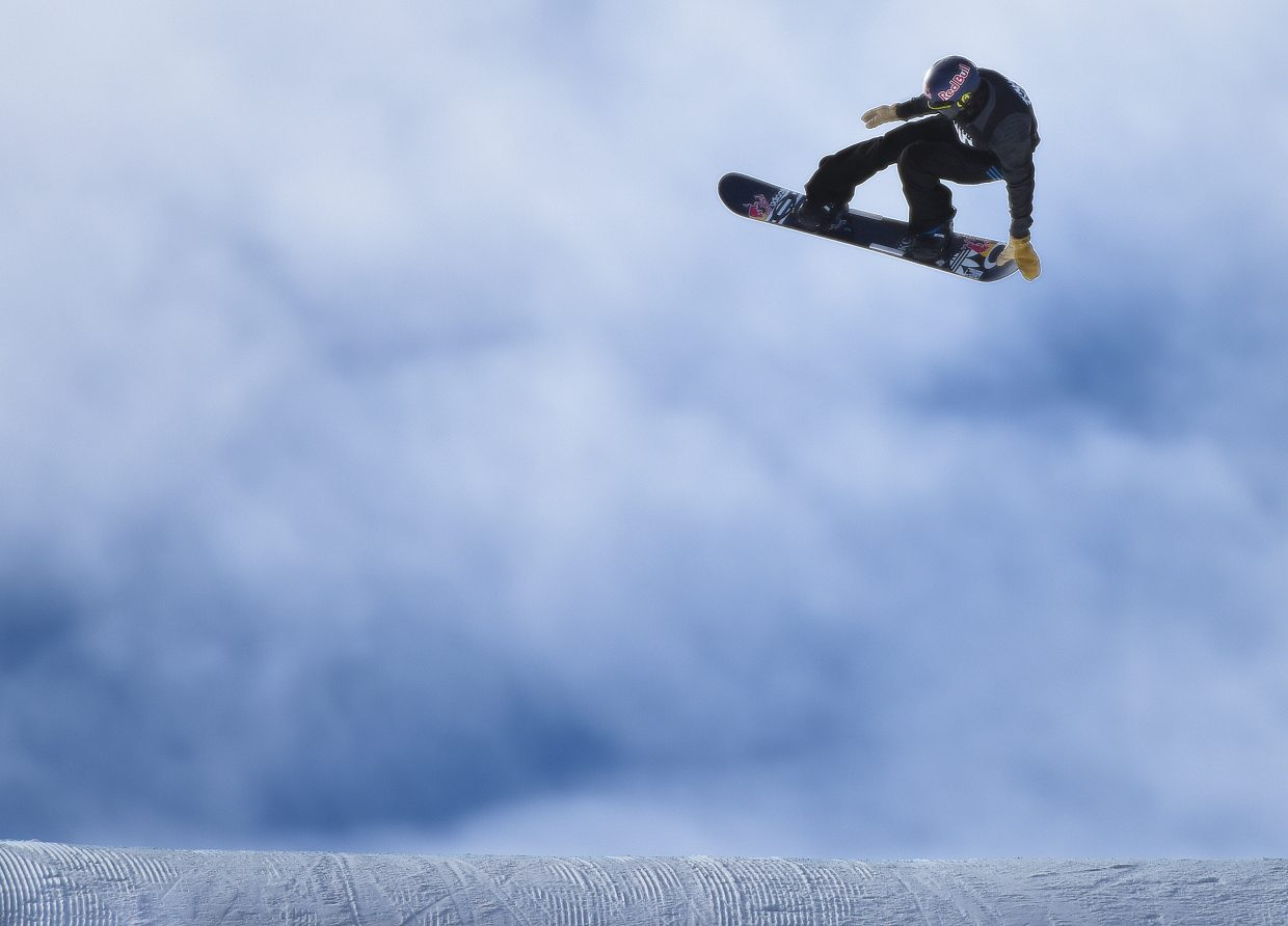"""Steamboat's Nik Baden spins off a jump Friday during the men's snowboard slope-style elimination round at X Games in Aspen. Baden landed his run on that, his second try, and it was good enough to put him in the top eight, which would have qualified him for finals. He wasn't """"in"""" long, however, as the next rider down bumped him to ninth, where he finished."""