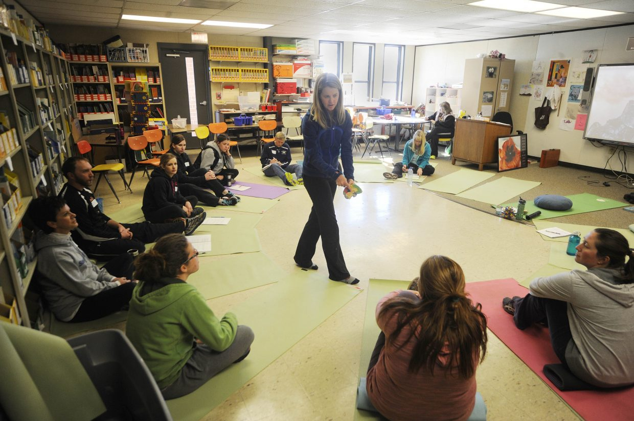 Kristen Race shows Hayden Valley Elementary School teachers a portion of the brain called the amygdala during a daylong training Friday at the school.