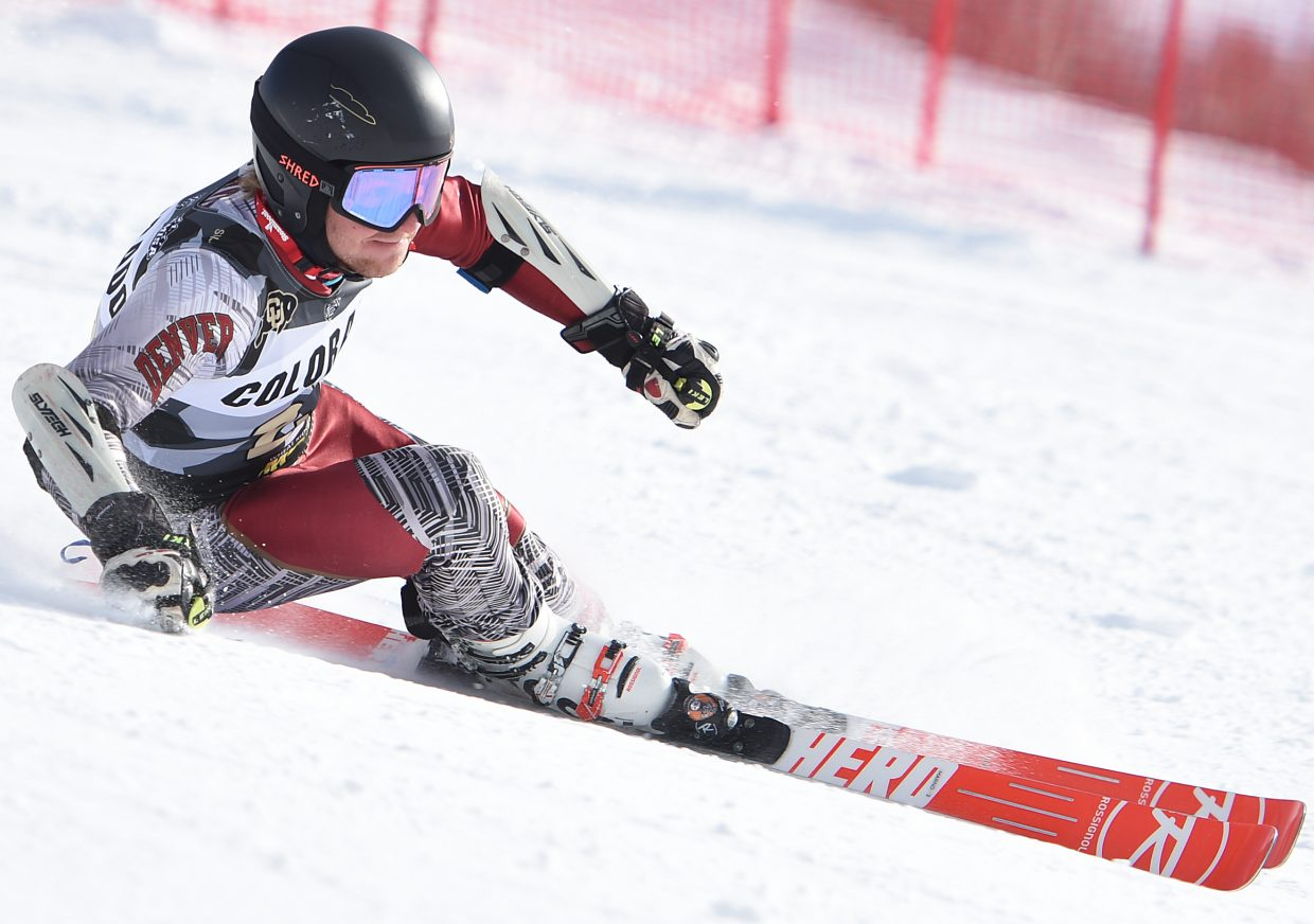 University of Denver skier Max Marno digs hard to cut around a gate Saturday at a NCAA giant slalom ski race at Steamboat Ski Area.