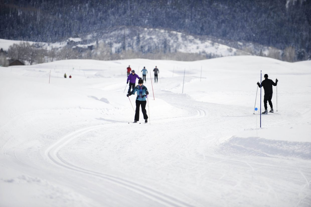 People ski during the Ski for Parkinson's fundraiser Saturday at Haymaker Golf Course.