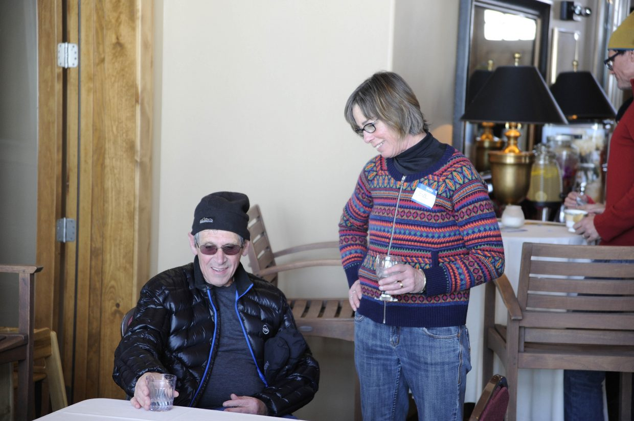 Parkinson's disease exercise instructor Eva Gibbon visits with her client Angelo Boeri during the Ski for Parkinson's fundraiser Saturday at Haymaker Golf Course.