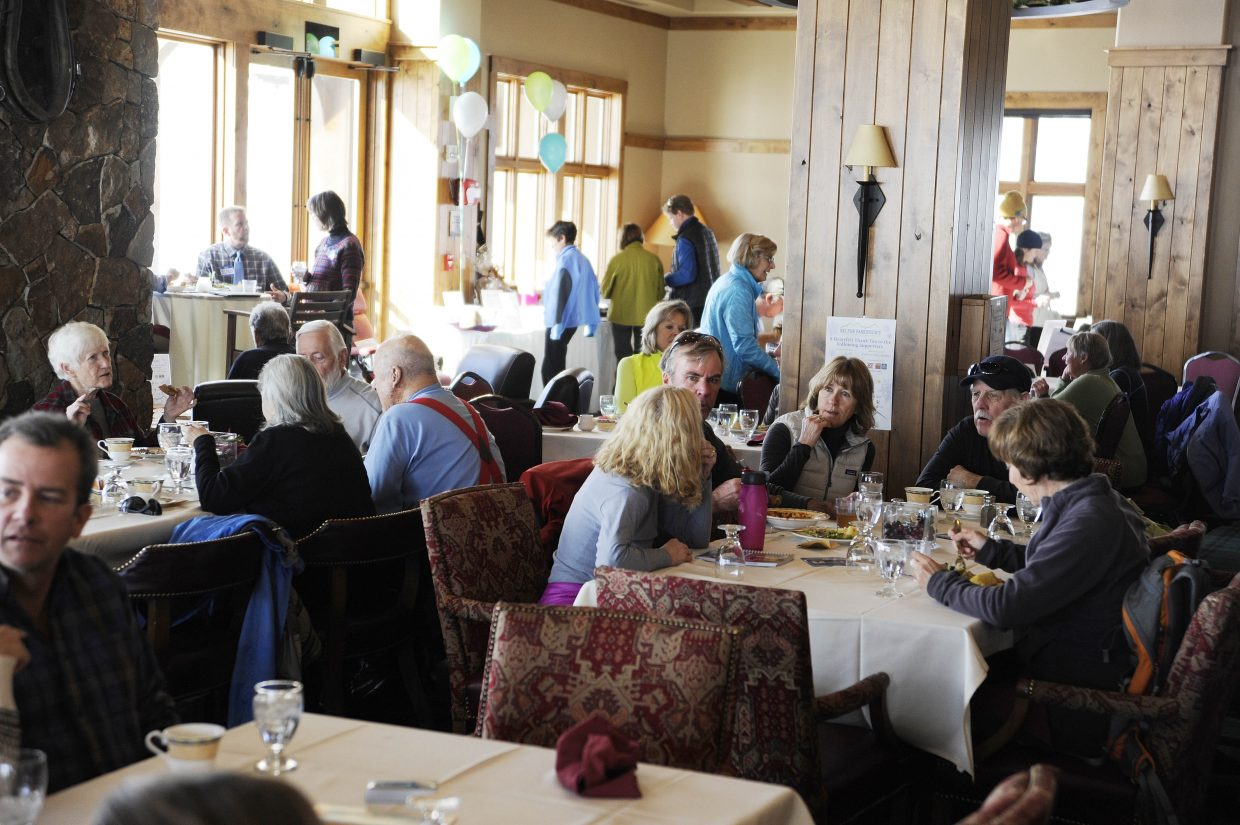 People have lunch during a previous Ski for Parkinson's fundraiser at Haymaker Golf Course.