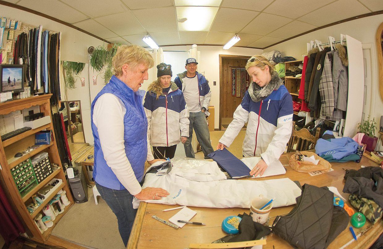 Hannah Kearney, 2010 Olympic gold medal mogul skier, talks with Sew What owner Maggie Bentz about adding a knee patch to her U.S. Ski Team Olympic uniform. Bentz is adding the patches to all of the freestyle athletes' pants before the team leaves for the 2014 Winter Olympic Games in Sochi, Russia. Mogul skier Heidi Kloser was also there to drop off her uniform along with American moguls coach Scott Rawles.