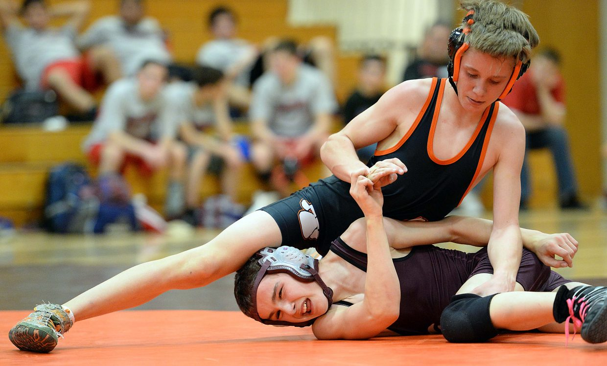 Hayden's Tyler Hockaday holds down Soroco's Lane Martindale on Friday during a triangular wrestling meet in Hayden. Hockaday won the match against his Ram counterpart, 10-5, and the Tigers won both duals on the night, against Soroco and Glenwood Springs.