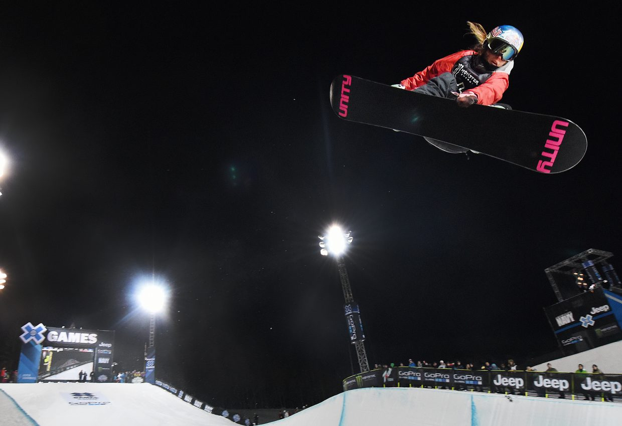 Arielle Gold flies above the half-pipe at X Games in Aspen on Saturday. Gold placed fourth in the event for the second consecutive year.