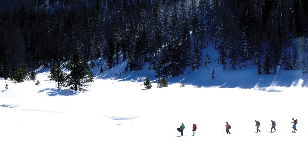 Students in an entry-level avalanche awareness class offered by Colorado Mountain College head into the backcountry to learn the basics of companion rescue.