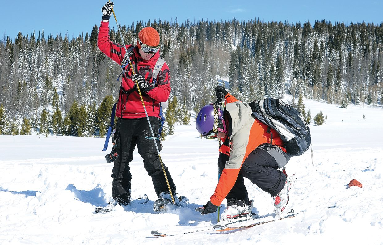 Student Ignacio Escarpenter uses a beacon as classmate Blake Peters attempt to find a lost item during an avalanche rescue scenario at the top of Buffalo Pass. The students were taking part in an avalanche awareness class offered by Colorado Mountain College. The course was a mix of in-class, and field learning.