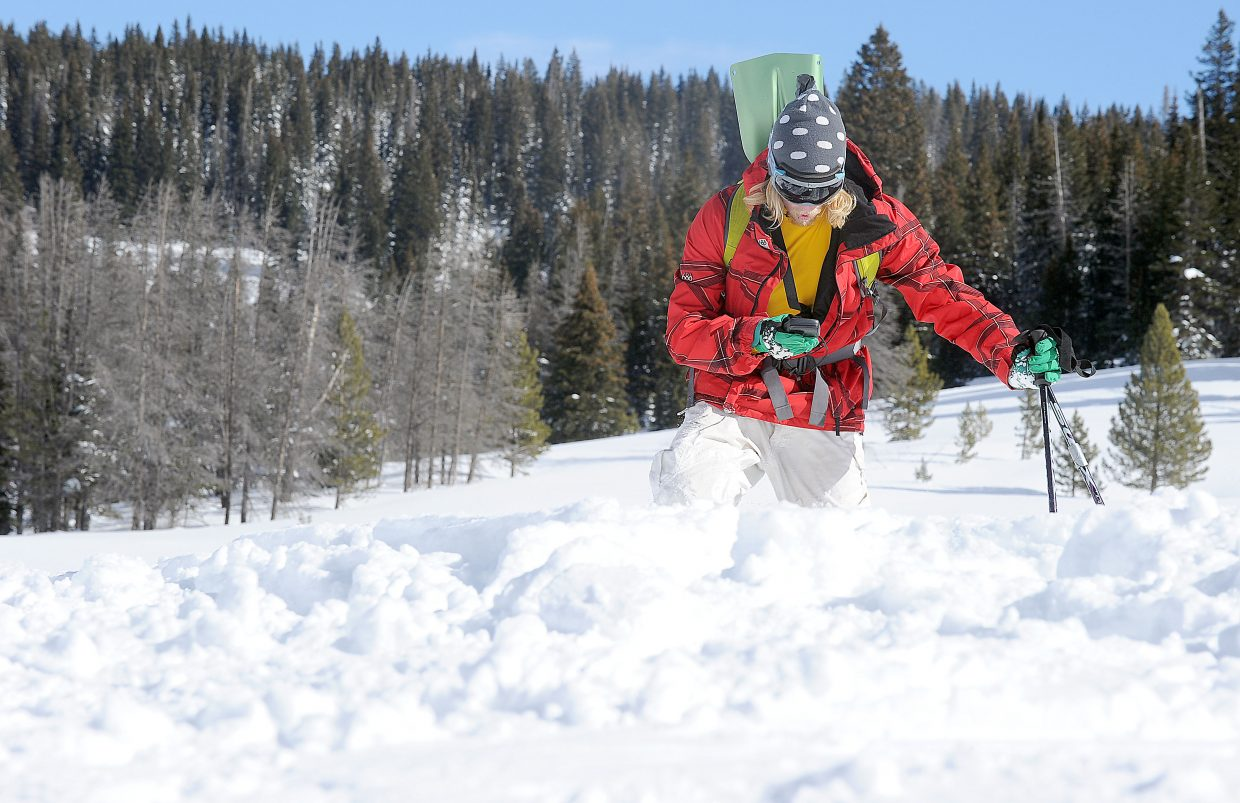 Colorado Mountain College student Tristan Mundt searches for a lost beacon while practicing a backcountry rescue near the top of Rabbit Ears Pass. As part of the class, students trekked into the backcountry and practiced scenarios that reinforced what they learned in the classroom.