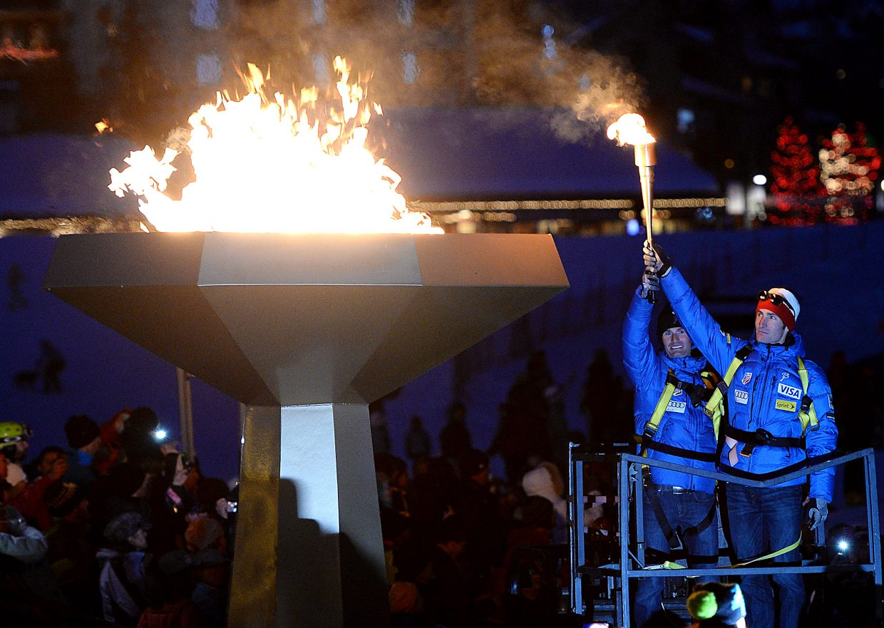 Bryan and Taylor Fletcher, heading to the Olympics in Nordic combined, hold up the torch after lighting the Olympic flame in Steamboat Springs. The lighting of the flame was the finale of a sendoff event for athletes heading to Sochi, Russia for the Winter Olympics.