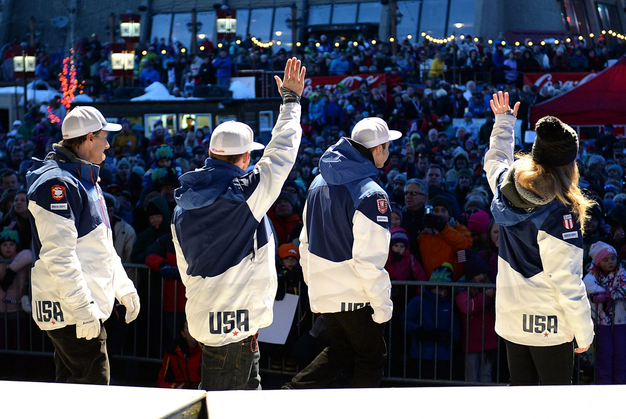 Members of the U.S. Olympic Freestyle skiing team wave to the crowd gathered Saturday for the Olympic sendoff event at Steamboat Ski Area.