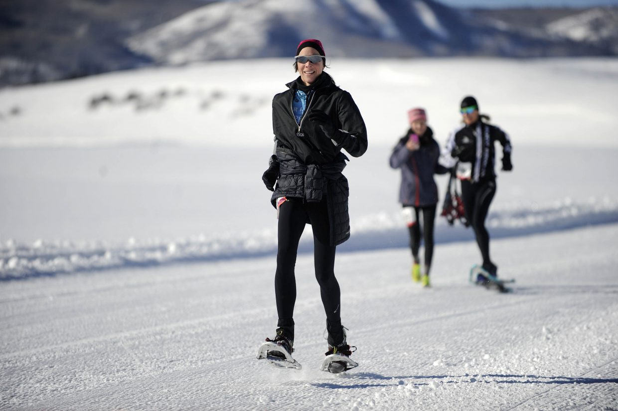 Kirsten Schoew, of Littleton, finishes the 5-kilometer course Saturday during the first Steamboat Snowshoe Series race at Catamount Ranch & Club.