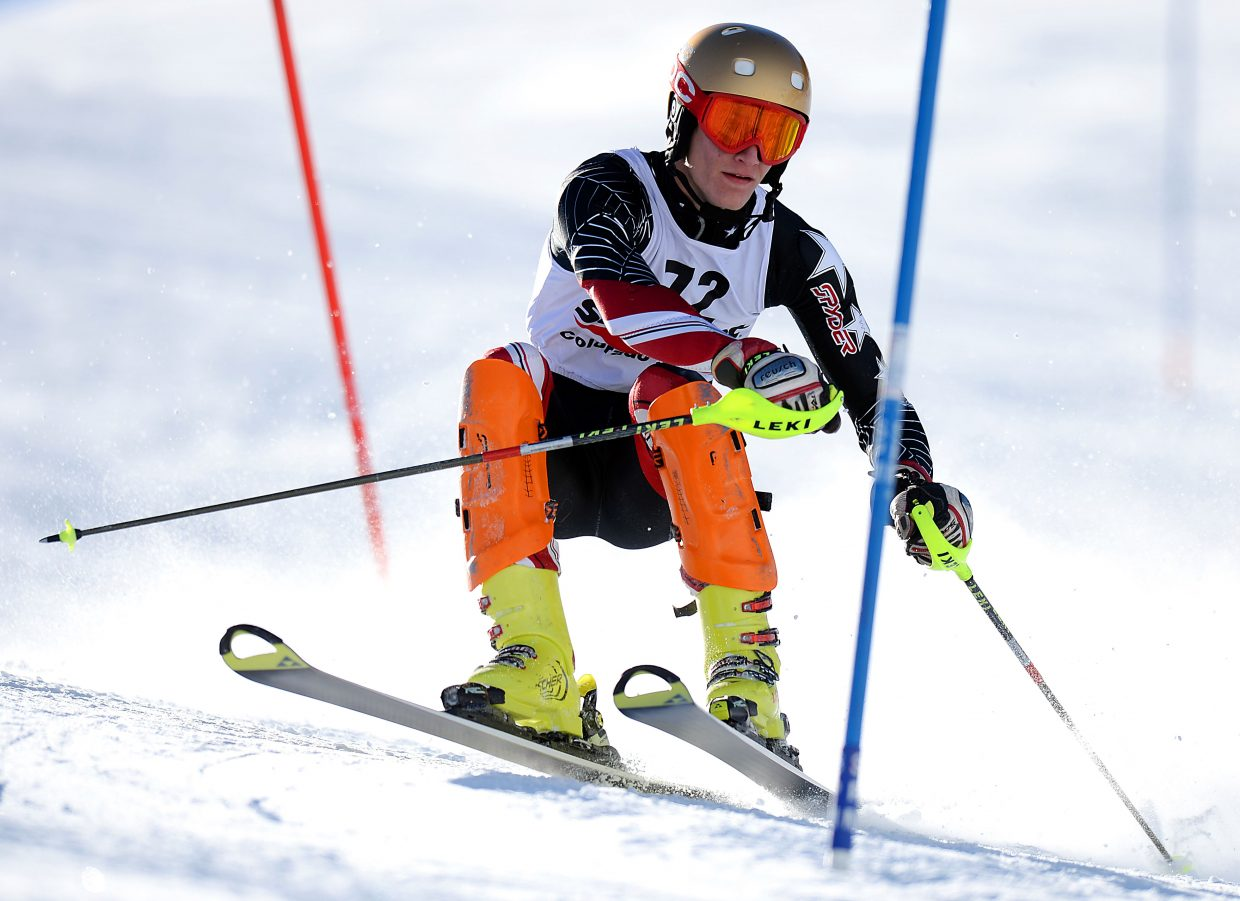 Steamboat's Keegan Millard catches some air cutting around a corner Sunday at Howelsen Hill in Steamboat Springs during a Colorado Ski Cup race.